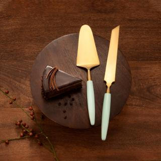 green gold metal and resin cake server set