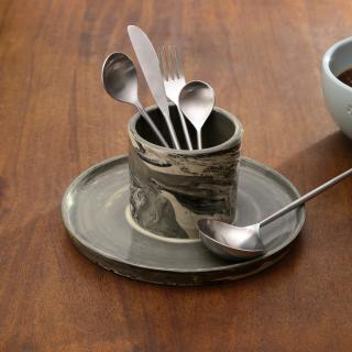 Carbon cutlery holder with spoon rest