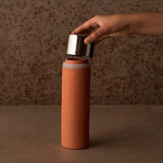 terracotta water bottle with metal cap