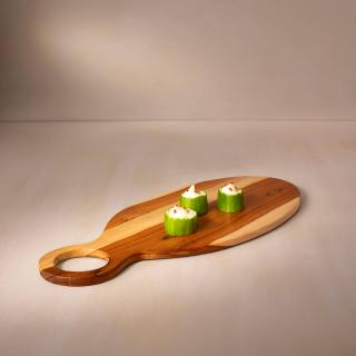 in teak wooden cheese/bread board oval