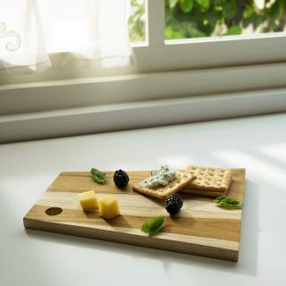 in teak wooden cheese/bread board asymmetric